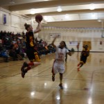 BHS Senior Rachel Howard goes for a basket in 54 - 44 Win against McClymonds.