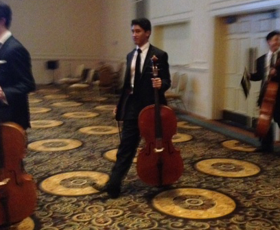 Will Cayanan walking in with other cellos.