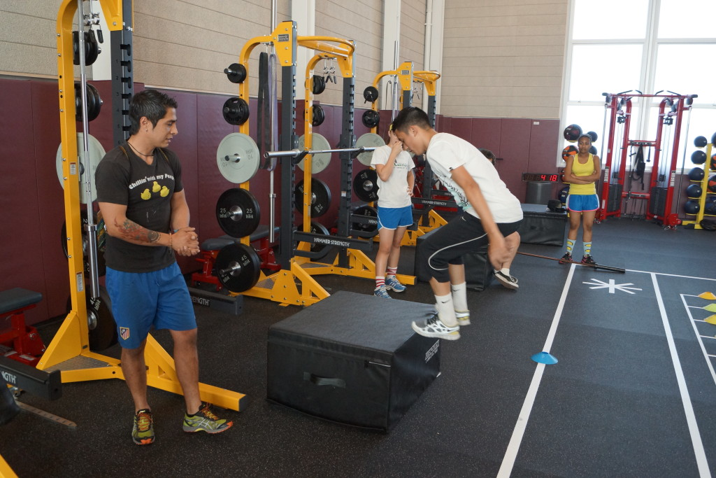 A Part-time Conditioning Trainer Works with Students to Insure Safe and Effective Use of the Fitness Center
