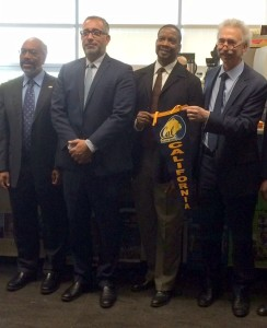Chancellor Dirks and Provost Claude Steele present Cal's pennant to BHS Principal Scuderi and Superintendent Evans to hang in the BHS College and Career Center.