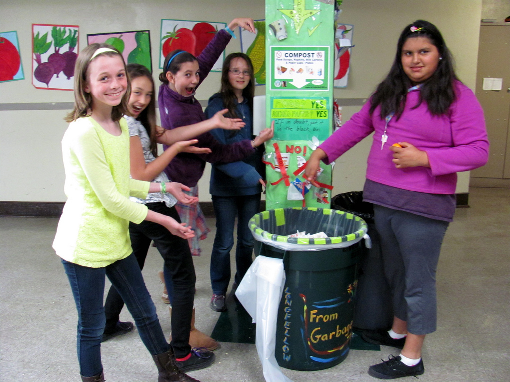 Longfellow Green Tigers help monitor waste sorting in 2013 to improve composting.
