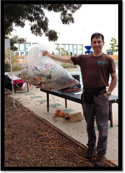 Parent Larry Kass after the BAM Jam, showing the small amount of trash created at the school-wide event, thanks to multi-sort outdoor waste stations.