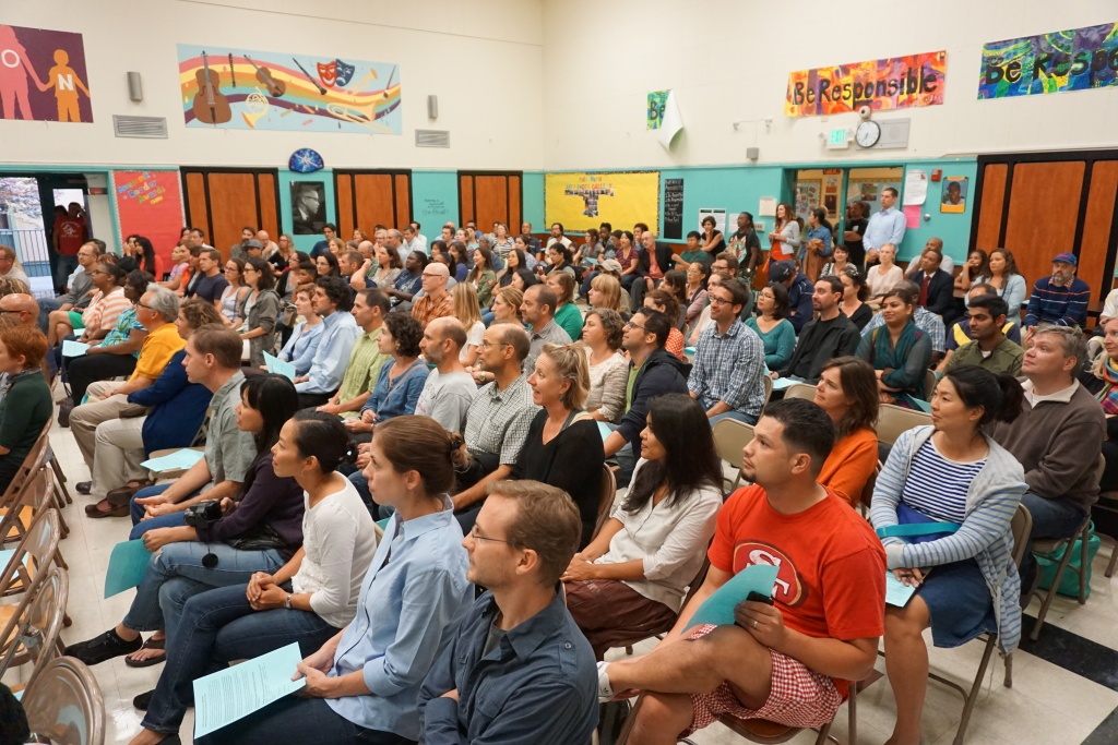 Emerson parents fill the auditorium for a brief program with the principal before going into the classrooms with the teachers