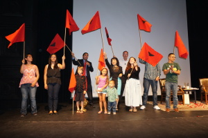 "Farm worker rights advocate Dolores Huerta ""Passing the Torch"" to Berkeley youth with flags"