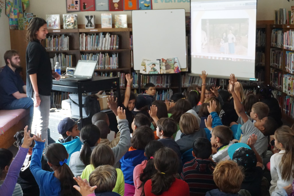 Author-Illustrator Angela Dominguez responds to excited students during her school library visit.