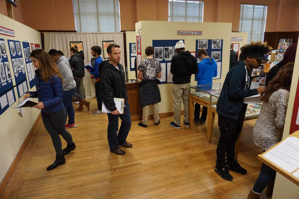 BHS students visiting the Berkeley Historical Society's current exhibit on civil rights
