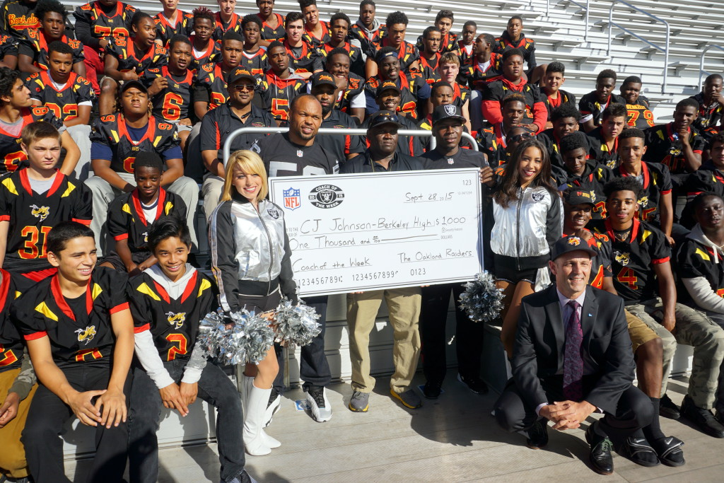 BHS Football Coach Johnson (center) Named Raiders High School Coach of the Week