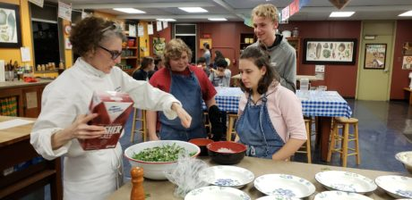 Photo of Bonnie Christensen conducting meal preparation class at Berkeley High School