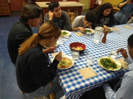 Photo of Berkeley high school students enjoying the meal they prepared