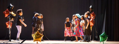 Photo of elementary students performing in Black History Oratorical Fest