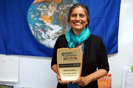 Photo of Jackie Omania in 2015 with her Green California Leadership Award