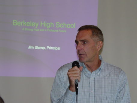 Jim Slemp at the microphone addressing a BUSD audience.